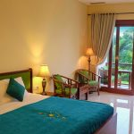 Deluxe Farm Room interior with double bed and outdoor view