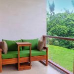 Green sofa by Deluxe Farm Rooms' terraces